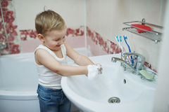 Boy playing with shaving foam Stock Photo