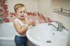 Boy playing with shaving foam Royalty Free Stock Image