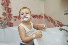 Boy playing with shaving foam Stock Photography