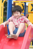 Boy playing on slide Stock Photo
