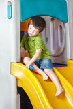 Boy playing on slide royalty free stock photo
