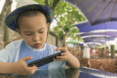 Boy playing smartphone Stock Photo