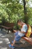 Boy using smartphone Royalty Free Stock Photography