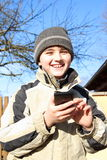 Boy playing with smartphone Royalty Free Stock Image