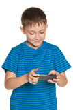Boy plaing with smartphone Stock Images