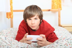 Boy  playing with smartphone Stock Images