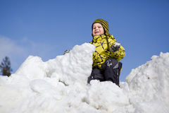 Boy playing in snow Stock Images