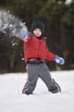 Boy playing in snow Stock Photo