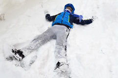Boy playing with snow Stock Photography