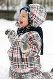 Boy playing in snow Stock Image