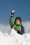 Boy playing snowballs Stock Photos