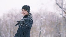 Boy playing snowballs stock video