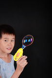 Boy playing soap bubble Stock Photography