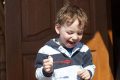 Boy playing with soap bubble Royalty Free Stock Photo