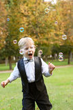 Boy playing with soap bubbles Stock Photo