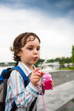 A boy is playing with soap bubbles. Royalty Free Stock Photos