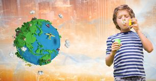 Boy playing with soap bubbles by low poly earth. Digital composite of Boy playing with soap bubbles by low poly earth Royalty Free Stock Photo