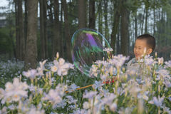 Boy playing soapbubbles Royalty Free Stock Photography