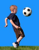 Boy playing soccer. Against the sky Royalty Free Stock Photography