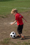 Boy playing soccer. Young boy enjoys playing soccer Stock Image