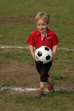 Boy playing soccer stock images