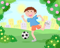 Boy playing soccer. At the park with a city in the background Royalty Free Stock Photos
