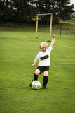 Boy playing soccer Royalty Free Stock Photo