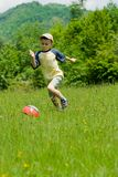 Boy playing soccer Stock Photos