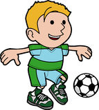 Boy playing soccer Stock Image