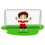 Boy playing soccer as GoalKeeper Stock Photography