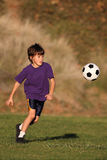 Boy playing with soccer ball stock image