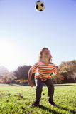 Boy playing with soccer ball in park Royalty Free Stock Photo