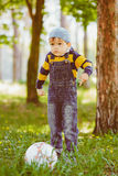 Boy playing with soccer ball at park Royalty Free Stock Images