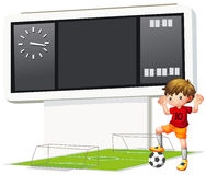 A boy playing soccer at the court Stock Photo