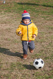 Boy playing with soccer or football ball. sports for exercise and activity. Stock Photography