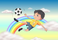 A boy playing soccer Royalty Free Stock Image
