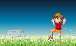 A boy playing soccer Royalty Free Stock Photography