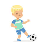 Boy playing soccer, kid kicking a ball colorful character vector Illustration Royalty Free Stock Images