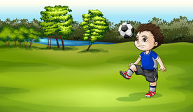 A boy playing soccer outdoor Royalty Free Stock Photo