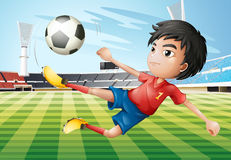 A boy playing soccer at the soccer field Stock Image