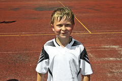 Boy after playing soccer Royalty Free Stock Image