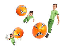 Boy playing soccer - wide angle shots Royalty Free Stock Photo