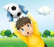 A boy playing soccer with a yellow uniform Royalty Free Stock Photography