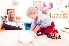 Boy is playing with some details. Boy is playing with some toys and thinking what to build royalty free stock images