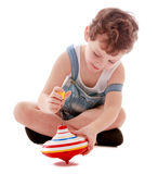 Boy playing with a spinning top Royalty Free Stock Image