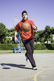 Boy playing sports. Young playing basketball sports center Royalty Free Stock Photo