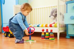 Boy playing with stacking rings Royalty Free Stock Photography