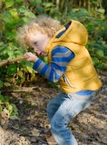 Boy playing with stick like with gun Stock Photos