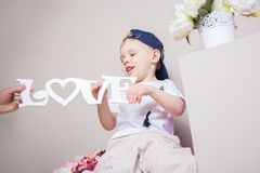Boy playing in the studio. many interesting details. Royalty Free Stock Photos