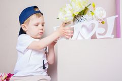 Boy playing in the studio. many interesting details. Royalty Free Stock Photography